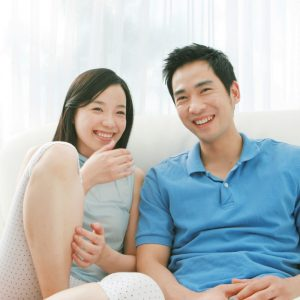 happy couple enjoying air conditioner